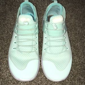 Nike Free mint green slip on shoe with cord ties